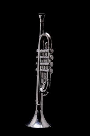key: Silver Vintage Toy Trumpet on a Black Background