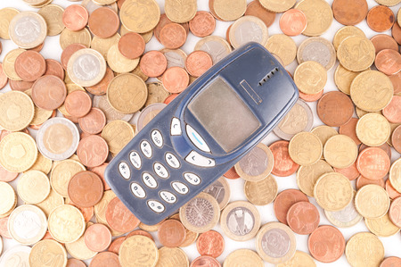 money concept: Picture of a Business Money Concept Idea, Phone and Coins Stock Photo