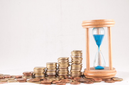 money concept: Picture of a Business Money Concept Idea Coins and Hourglass