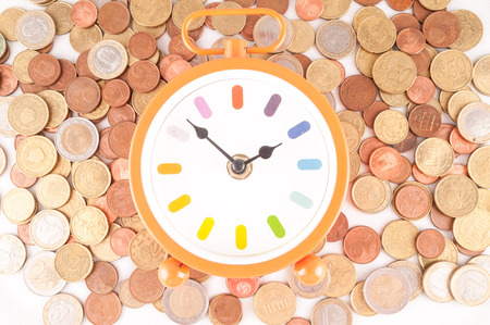 money concept: Picture of a Business Money Concept Idea, Clock and Coins Stock Photo