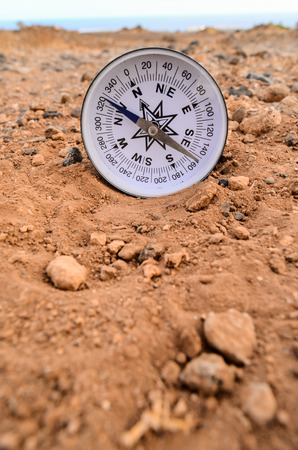 orientation: Orientation Concept Metal Compass on a Rock in the Desert Stock Photo