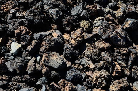 volcanic stones: Black volcanic stones soil texture in Lanzarote