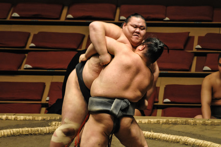 wrestler: Editorial TOKYO - MAY 2010: Unidentified wrestlers in the Grand Sumo Tournament in Tokyo, Japan on January Editorial