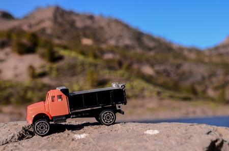 dumptruck: Transportation Concept Old Toy Truck on the Rocks