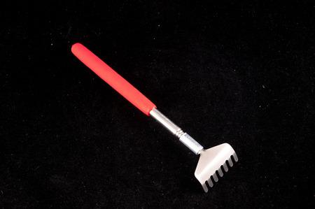 scratcher: Photo Picture of a Metallic Rake Tool