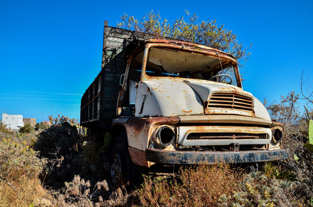 corrosion: Rusty Abandoned Truck on the Desert, in Canary Islands, Spain Stock Photo