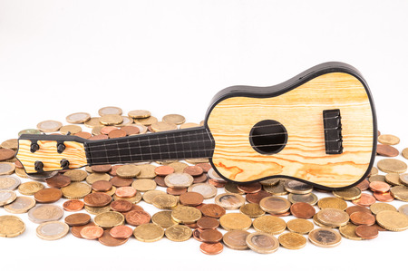 money concept: Picture of a Business Money Concept Idea Coins and Guitar Stock Photo