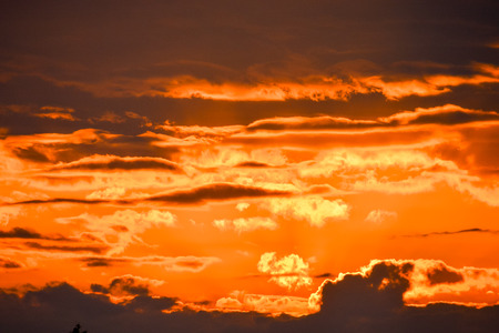 red sky: Cloudscape, Colored Clouds at Sunset near the Ocean Stock Photo