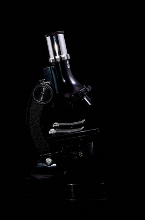 microscope isolated: Old Vintage Microscope Isolated Over Black Background