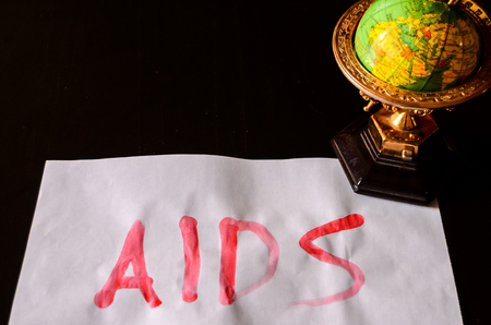 sexually transmitted disease: Word Aids Text Writed with Blood on a White Paper Stock Photo