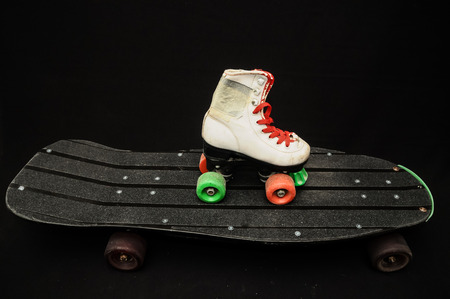 seventies: Vintage Style Black Skateboard and Skate Boot on a Dark Background