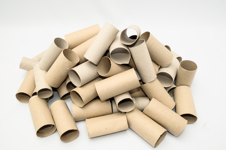 loo: Empty Toilet Rolls Stack Up On a Black Background