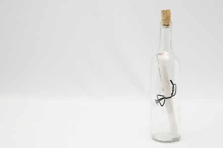message in a bottle: Message in bottle on a whire background