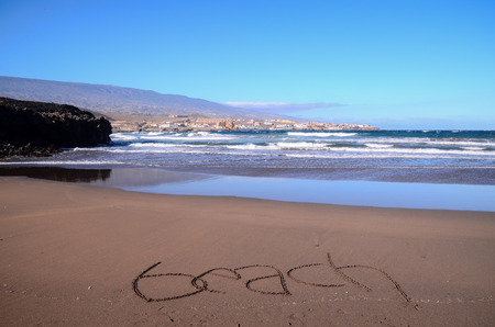sand writing: Word Written on the Sand of a Tropical beach