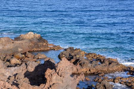 stone volcanic stones: Dry Lava Coast Beach in the Atlantic Ocean Stock Photo