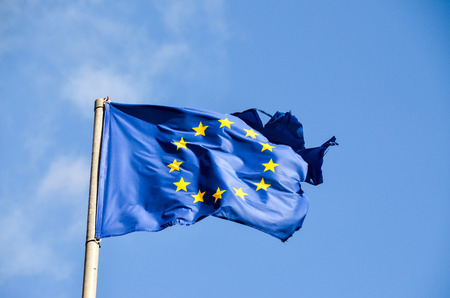 old flag: Old European Flag on a Blue Sky Stock Photo