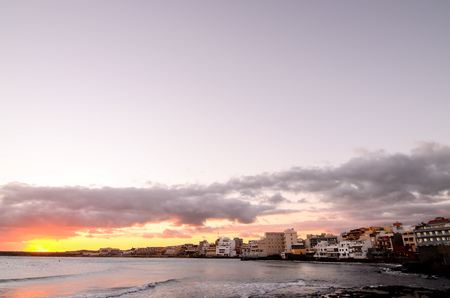 mediterranean coast: Sea and Building at Sunset in El Medano Tenerife Canary Islands