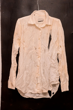 blemished: Old Vintage Ruined Grunge White Shirt Clothes Stock Photo