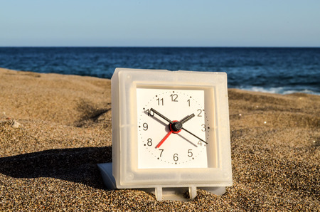 turistic: Photo Picture of a Clock on the Sand Beach