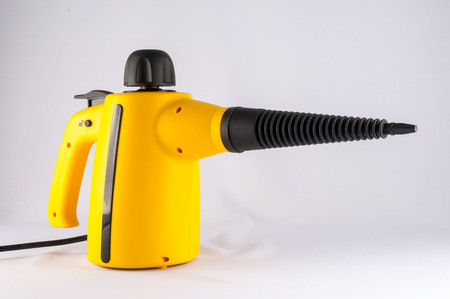 vapour: Picture of Yellow Hot Vapor Cleaning Machine Stock Photo