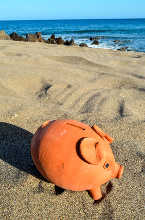 turistic: Photo Picture of Piggy Bank on the Sand Beach Stock Photo