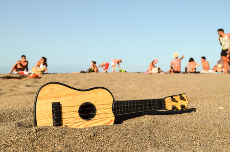 Photo Picture of a Guitar on the Sand Beach