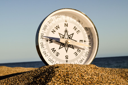turistic: Photo Picture of  a Compass on the Sand Beach