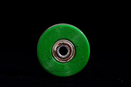 consumed: Old Vintage Consumed Skate Wheel on a Black Background