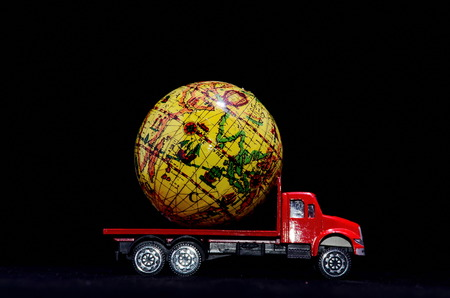 semitruck: Truck With Earth Globe Delivery Transportation Concept Stock Photo