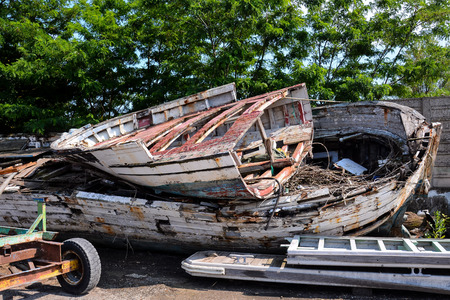 Photo picture Old and broken wooden boat stranded