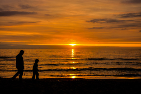 couple nature: Sun Setting on the Atlantic Ocean in North Europe Holland Stock Photo