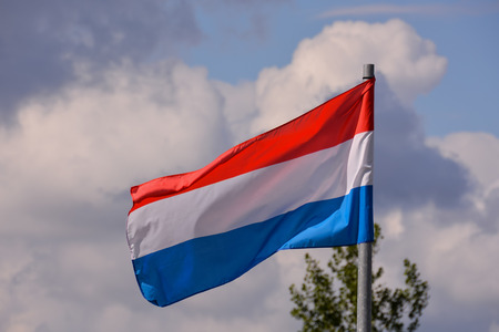 Photo Picture of a Moving french Flag in the Wind