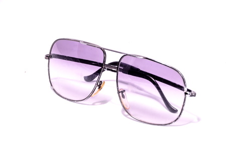 80s: Old Vintage 80s Style Sunglasses on a White Background