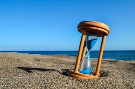 Hourglass Clock on the Sand Beach