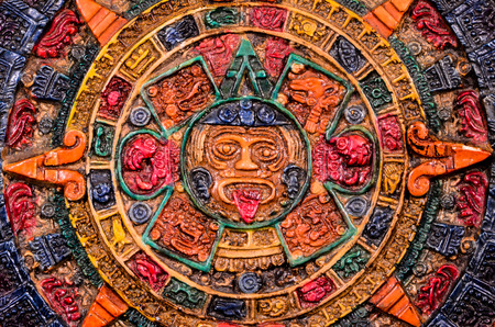 mexican ethnicity: Typical Colored Clay Maya Calendar Isolated on Blackbackground