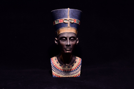 bust: Famous Statuette Bust of Queen Nefertiti Isolated on Black Background