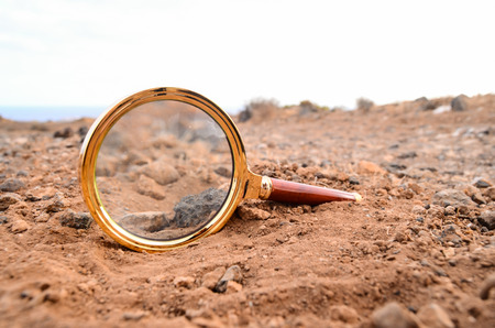 Magnify Glass Abandoned On The Rock Desert