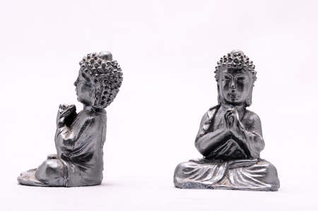 Oriental Asian Statue on a White Background Stock Photo