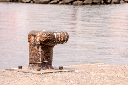 rusty metal: Photo picture of a Rusty metal mooring bolard for big ship