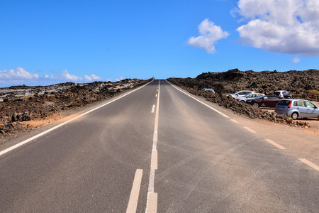 Long Empty Desert Asphalt Road in Canary Islands Spain Stock Photo