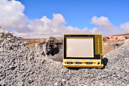 moab: Conceptual Photo Picture of a Television Object in the Dry Desert
