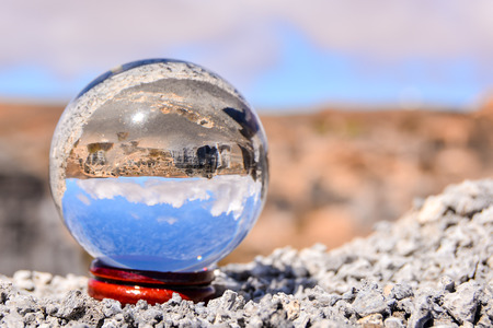 moab: Conceptual Photo Picture of a Crystal Sphere in the dry desert Stock Photo