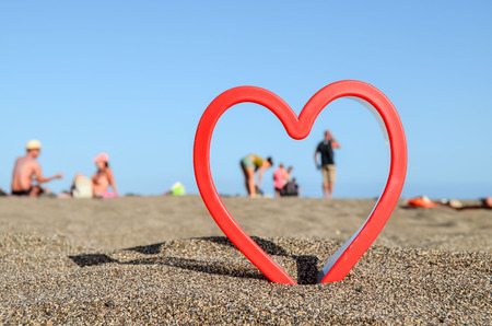 Photo Picture of an Heart on the Sand Beach Stock Photo