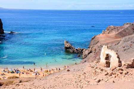 playa blanca: Spanish View Landscape in Papagayo Playa Blanca Lanzarote Tropical Volcanic Canary Islands Spain Stock Photo