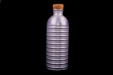 aluminium background: Antique Vintage Metal Aluminium Bottle on a Black Background
