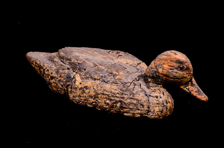 territorial: Vintage Goose Duck Decoy Cork Recall on a Black Background
