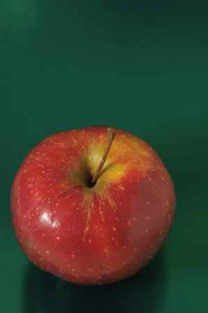 sins: One Juicy Hot Red Apple over a Colored Background