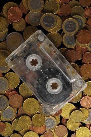 drug dealers: Money and Music Concept Tape Musicassette and Coins Stock Photo