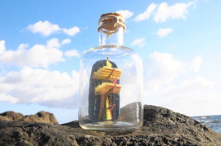 Ancient Spanish Sailing Boat in a Bottle near the Ocean Stock Photo