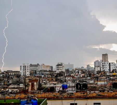 thundershower: A Lightning over the Rooftops in La Havana, Cuba Stock Photo